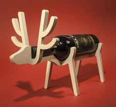 The reindeer wine rack is a perfect Christmas decoration gift for your families alcoholic. All you really know about them is that they love the booze, so what better gift to give them than a gift that. Unique Gifts For Men, Unusual Gifts, Christmas Gift Decorations, Christmas Crafts, Christmas Time, Wood Projects, Woodworking Projects, Woodworking Clamps, Custom Woodworking