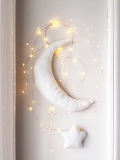 DIY moon and star on wall with fairy lights