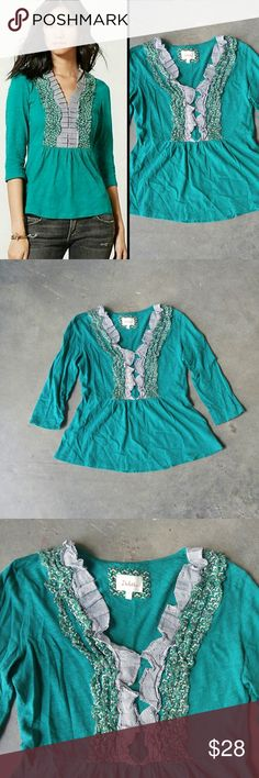 "Anthropologie Deletta Printed Ruffle Tuxedo Tee Delette brand top from Anthropologie, size medium, in excellent condition! Slight pilling. Ruffles don't lay flat but I think they look better that way. Color is between a teal and kelly green. Two different patterns on ruffles. V-neck and 3/4 sleeves. 18.5"" pit to pit, 24.5"" length. 100% cotton. Please ask any questions. No trades. Make a reasonable offer. Thanks! Anthropologie Tops Blouses"