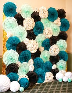 Glitter gold streamers with teal paper balls and gold polka dot tissue flowers make the perfect backdrop for a modern bat mitzvah by Michelle Edgemont