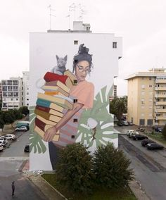 """""""Bookworm"""" by Artez, who says, """"You can lose your cup of tea, but never drop the knowledge you're carrying!"""", in Lecce, Italy, 10/17 (LP)"""