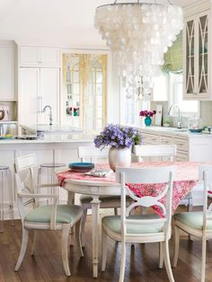 This light and feminine #kitchen and dining area is a show-stopper #hgtvmagazine http://www.hgtv.com/design/decorating/design-101/get-a-fresh-start-with-a-new-decorating-style-pictures?soc=pinterest