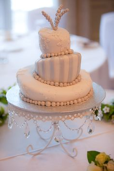 Our whimsical snowflake topsy turvy wedding cake - red velvet! (photo by splashphotography.ca)