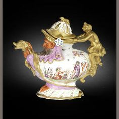 A Meissen Hausmaler grotesque teapot & cover, circa 1726-30. Of globular form as a bearded man squatting on a shell covered by a cloak & holding the gilt fish spout, gilt handle composed of a caryatid figure with scroll terminal supporting a centaur, decorated in Augsburg by Anna Elisabeth Wald with a chinoiserie scene on each side on a gilt scrollwork bracket, purple drapery decorated with incised foliate scrollwork, figure in orange fleshtones, shell base embellished in green & gilding...