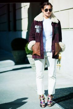 Danielle Bernstein pairs a ribbed sweater with a corduroy and shearling jacket, cropped jeans, star-print boots, and aviator sunglasses