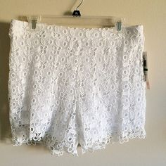 NWT lace high shorts These white lace shorts are new with tags! Cute with a crop top and tights! Size large Macy's Shorts