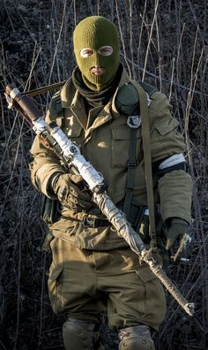 A Russian-backed separatist sniper smokes a cigarette near the village of Vergulivka Ukraine Feb. 13 2015 [1072 1800]