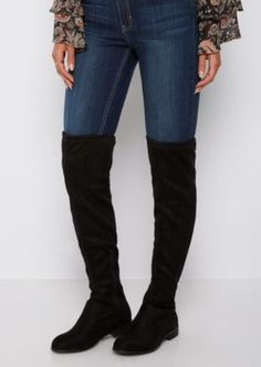 This over the knee boot features a fashion tie at the backs of the knees and finishes with a flat heel.