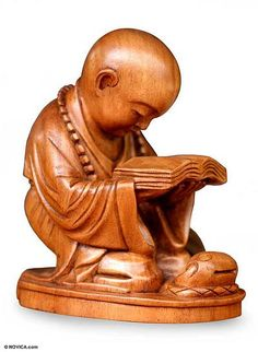 Wood statuette, 'Reading Buddha'. Shop from #UNICEFMarket and help save the lives of children around the world.