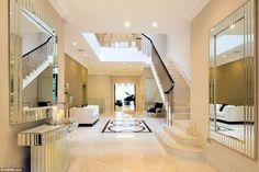 Reflections: This mirrored entrance hall and multi-storey atrium makes for an impressive s...