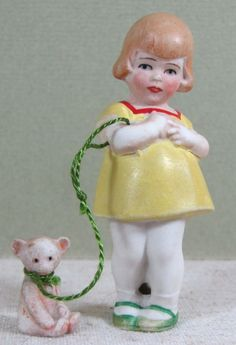 The German Hertwig firm did a series of these darling all bisque children with their pets on leashes.  This is probably my favorite pair, being