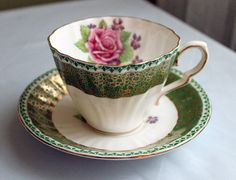 Porcelain Tea Cup and Saucer. Tea or Coffee Set Hand Painted by Gladstone in England. Marked # 6057 in gold. It has ornate rim with 22 karat gold over dark green background. Rose and violets painted inside of cup and in saucer center. Tea Sets Vintage, Vintage Cups, Antique Tea Cups, China Tea Sets, Chocolate Cups, My Cup Of Tea, Coffee Set, Tea Cup Saucer, Tea Pots