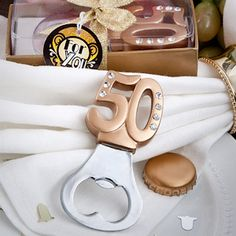 Golden 50 Anniversary Favor Bottle Openers (FashionCraft 4892) | Buy at Wedding Favors Unlimited (http://www.weddingfavorsunlimited.com/50th_design_bottle_openers.html).