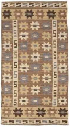 A Swedish Rug BB4950 - A Swedish Flat Weave Rug rendered in nuetral shades of brow,n grey and tan with ivory.