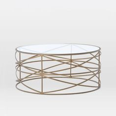 BRASS ROUND COFFEE TABLE | Sculptural Brass Coffee Table | Discover more coffee tables ideas: www.bocadolobo.com #moderncoffeetables #luxurycoffeetables