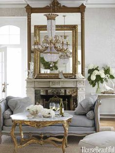 """The mantel shelf holds one of the designer's hallmark """"extreme juxtapositions"""": a massive empty picture frame, propped against the mirror, alongside antlers her children collected on hikes. Design: Annie Brahler"""