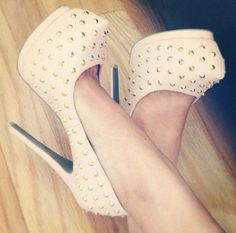 Love the powder pink high heels with gold studs!
