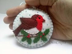 Felt christmas ornament - robin bird / wool blend felt/ white background This listing is for 1 ornament Size about 8 cm Material wool blend felt Handmade from felt with high precision and great care Please note that ornaments are decorated on one side only. Other side is solid white. This is made to order item. For more Christmas ornaments visit my Christmas section https://www.etsy.com/shop/DusiCrafts/Items?section_id=15537694 For personalized orna...