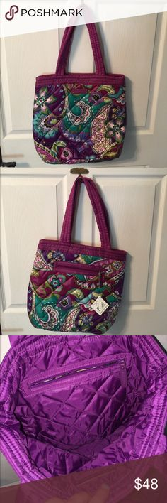 "Vera Bradley Puffy Reversible Tote Heather. Tote is completely Reversible. Either with pattern side or plain dark purple. Exterior one zip pocket. Interior features one zip pocket. Dimensions 15 1/2"" w x 14 1/2"" h. Strap drop 11"". Vera Bradley Bags Totes"