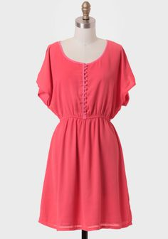 SRendered in saturated coral chiffon, this feminine dress features a row of front keyhole button closures and charming butterfly sleeves with an alluring slit design. Finished with pink contrast piping and an elastic waistband for a defined fit, this dress pairs well with wedges or strappy heels for an outdoor party or summer wedding. Fully lined.