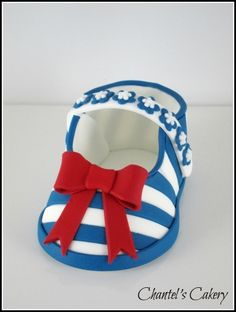 Stripy baby shoe in sugar paste. What a great cake topper for a baby shower cake.