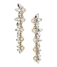 Silver-colored. Long metal earrings with faceted glass stones and plastic beads. Length 3 1/2 in.