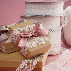 Gift wrapping ideas - make your packages look elegant with a touch of lace trim and satin ribbon. Lace trim is prefect for embellishing clothes and home decor also. There are many DIY possibilities!