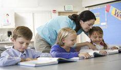 Teacher Helping Schoolkids