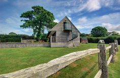 Bella's Place is a sumptuous timber clad studio apartment overlooking lush green scenery just three miles from the maritime port of Falmouth. Green Scenery, Lush Green, Studio Apartment, Falmouth Cornwall, Cottage, Easter Weekend, Cabin, The Originals, House Styles