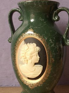 Hey, I found this really awesome Etsy listing at https://www.etsy.com/listing/176039030/vintage-mount-clemens-pottery-cameo-vase