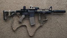 Colt AR 5.56 w/EOTECH & silencer.. Want it