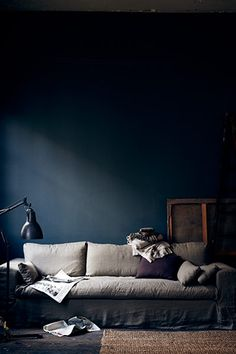 The new interiors colour palette: aubergine and indigo  | The inspiration: a relaxed living room with petrol blue walls, a slubby linen sofa, and accessories in shades of grey and plum | The Guardian - Photograph: Pia Ulin
