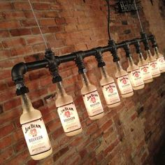 Remove the labels or use something non-boozy and I totally want this!   Iron Pipe Bottle Lamp Industrial Chandelier by Peared