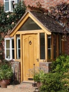 porch, mix of wood and brick with glass surrounds.Small porch, mix of wood and brick with glass surrounds. Porch Uk, Front Door Porch, Cottage Porch, Porch Doors, Front Porch Design, House With Porch, House Front, Porch Designs, Enclosed Front Porches