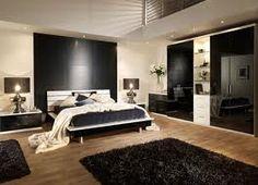 Unisex room with light wood flooring and dark furniture