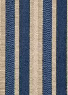 Marwood Stripe Upholstery Fabric A woven and velvet striped cloth in marine blue and beige.