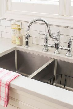 I love this faucet! It is Waterhill in chrome by Moen. The counter is Silestone Lagoon in a suede finish. Blanco sink. Vanessa Francis Design.