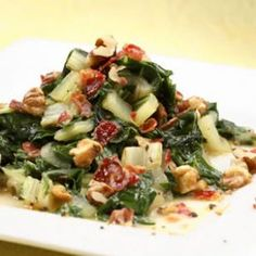 Chard with Shallots, Pancetta & Walnuts (but subbing green onions, bacon, and pinenuts. . . guess it's not the same recipe :-)