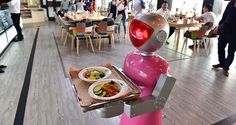 A robot waitress delivers meals for customers at robot-themed restaurant on May 2015 in Yiwu, Zhejiang province of China. (Image source: ChinaFotoPress via Getty Images) Robot Restaurant, Chinese Restaurant, Robot Revolution, Digital Revolution, Fast Food Workers, Japanese Language Proficiency Test, Open S, Unique Restaurants, Minimum Wage