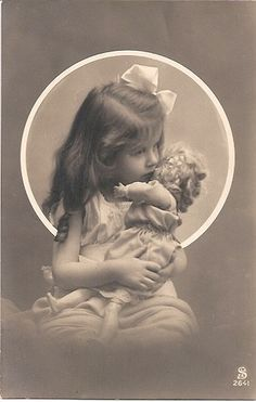 Little girl and her doll.