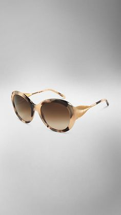 Burberry Oversize Round Frame Sunglasses from The Gabardine Collection -Oversize round frame acetate sunglasses. Gold metal draped gabardine temples are inspired by the fabric of the trench coat, English-woven cotton gabardine, invented by Thomas Burberry in 1879. Discover more accessories at Burberry.com