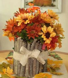 Using branches from your backyard, attach them to an empty coffee can with hot glue, then fill with flowers. So pretty & so easy!
