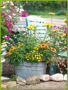 galvanized wash tubs in the garden | Found on forums.gardenweb.com