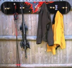 Snowboard Coat Rack | Not a how to, but count - 5 centered paired pegs, 4 upper…