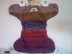 "Girasol ""Earthy Rainbow"" Wrap scrap PUL diaper cover.  I've never seen a wrap used for a diaper~"