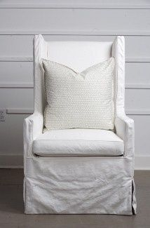 White slipcovered boxy wingback chairs~ it's true love every time! Available at Cerulean Interiors 850-249-3873.