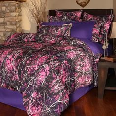 "The Muddy Girl 3-Piece Twin Bed Set is a bold, feminine statement for the rough-and-tough camo buff! Disruptively patterned branches stand out in sharp relief against a dark purple background, creating a wild and outdoorsy look. 100% polyester Includes comforter, bedskirt and one standard sham 67""W x 89""L comforter Machine wash warm, tumble dry low Muddy Girl® pink and purple camo  ~ Ships from the manufacturer. Allow 2 to 3 weeks. Cannot express ship."