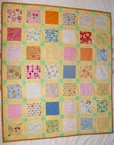Speedy Charm Pack Baby Quilt Pattern - Learn how to make a baby blanket DIY with this charm pack quilt pattern that is perfect for beginners.