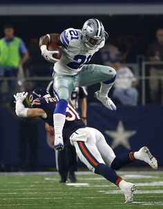 Cowboys RB Ezekiel Elliott couldn't go around Chicago Bears defender Chris Prosinski in Week 3, so he did the next best thing: went over him. (AP/Jenkins)