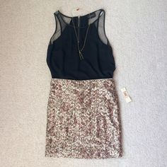 Gold-Sequined, High-Waisted Skirt NWT gorgeous gold-sequin, fitted, high-waisted skirt! Fabric has a lot of give. Find the Marc Jacobs Wishbone necklace for sale in my closet! Please use the offer button & check out my closet for bundle deals! Skirts